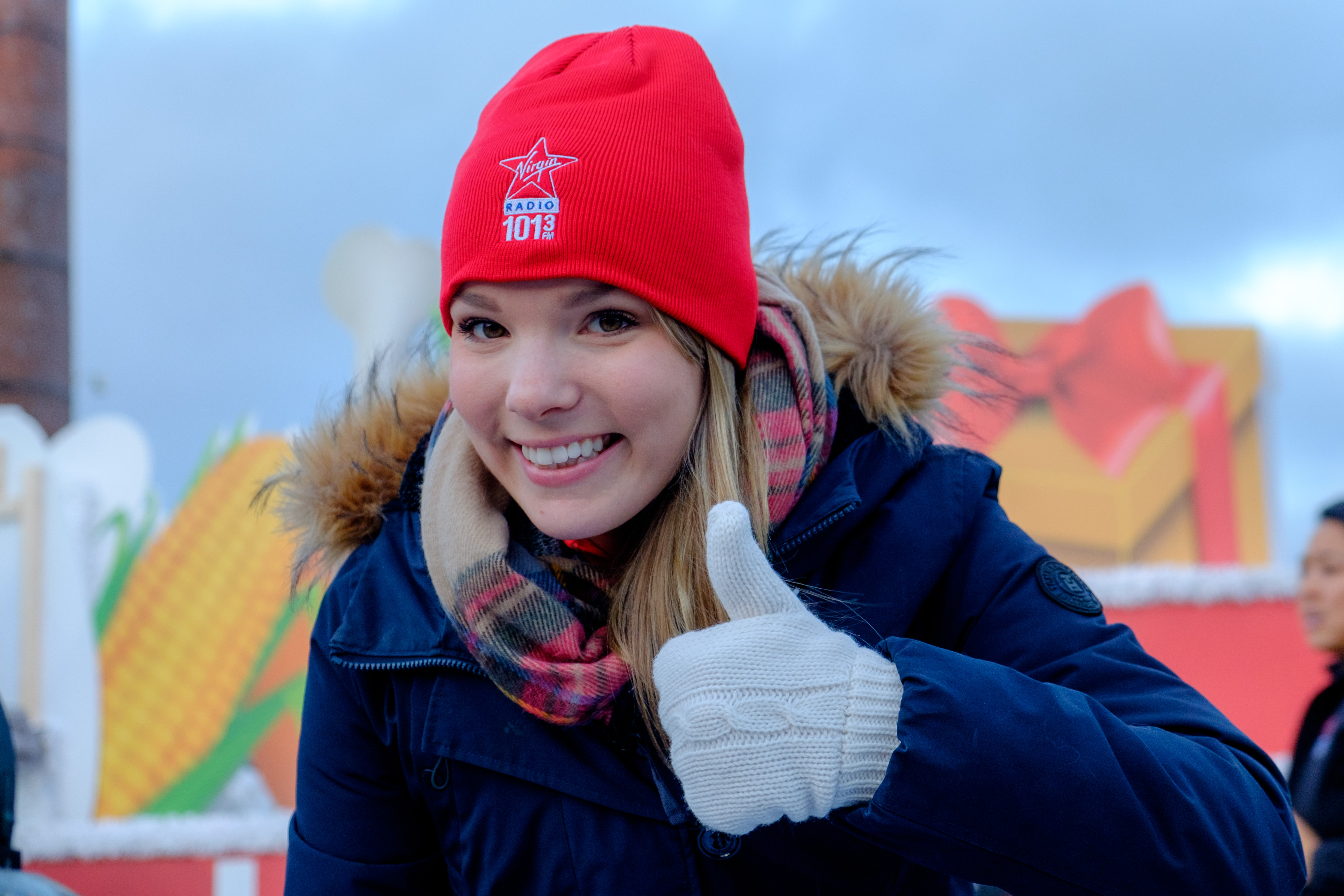 Woman in toque with thumbs up
