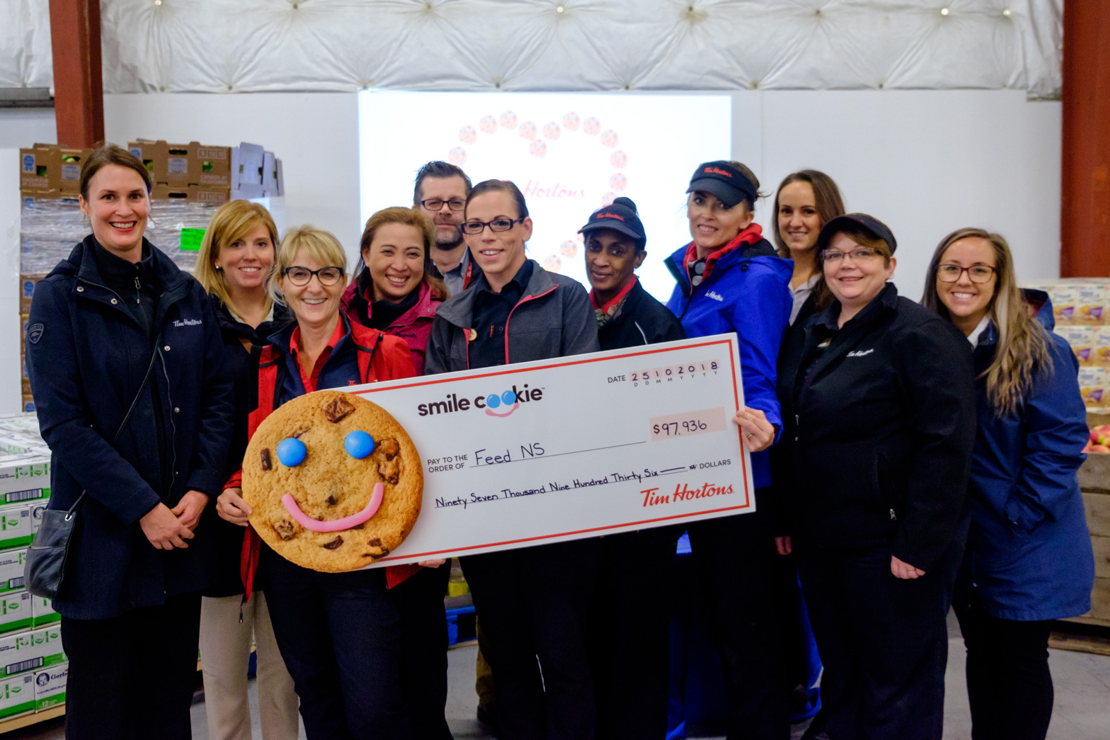 Tim Hortons staff with a big cheque from the Smile Cookie campaign