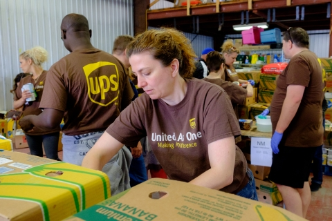 A UPS employee sorts food in the Feed Nova Scotia warehouse