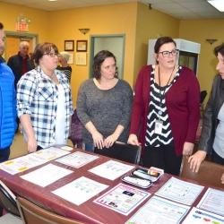 Ally Centre and Glace Bay Food Bank staff talk with DCS employees
