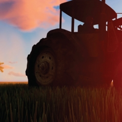 farm tractor in a field at sunrise