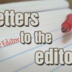 A pen and a paper with the words letter to the editor on it