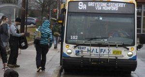 passenger about to board the number nine transit bus to Greystone