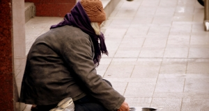 a homeless woman on a city sidewalk