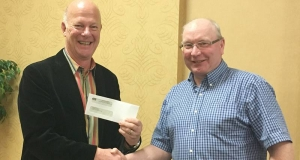 Nick Jennery receives a cheque from Victor Oulton