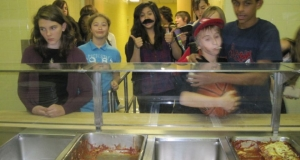 School children lined up at the cafeteria counter