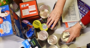 people sorting a food bank order